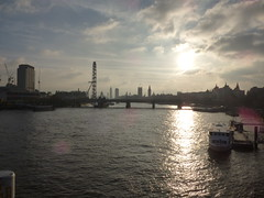 View from the Waterloo Bridge over the River Thames in London - London Eye, Hungerford Bridge and Palace of Westminster