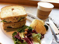"bummed that my almost filled stamp card expired. on the other hand, got my ""girls"" checked as well a physical done...brunch! love their chicken sandwich with avo, sauerkraut & I think some pâté♡  #standardbookstore茶屋町 #osaka #japan"