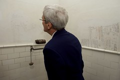 U.S. Secretary of State John Kerry looks at daily weight measurements scribbled onto a wall above a scale in the bathroom of author Ernest Hemingway at Finca Vigia - his former home in San Francisco de Paula, Cuba - during a tour on August 14, 2015. [State Department photo/ Public Domain]