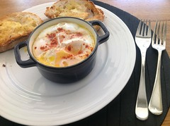 Baked eggs with potato, olives, semi-dried tomato…