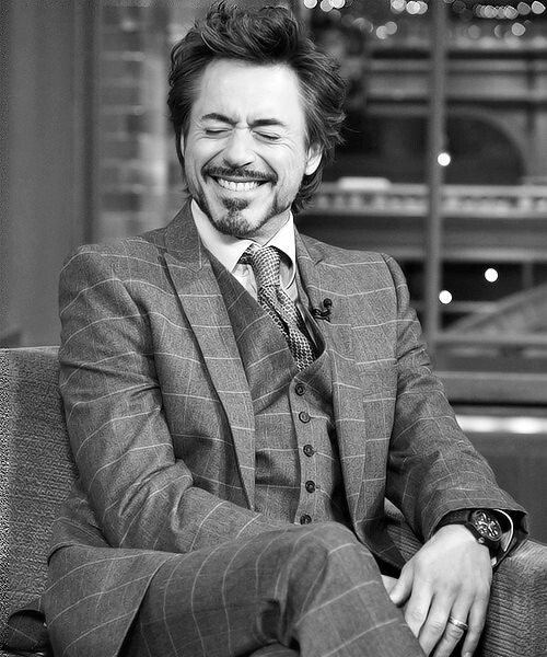 Robert Downey Junior crossed legs