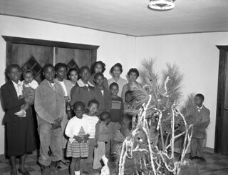 Group gathered around the Christmas tree in Tallahassee