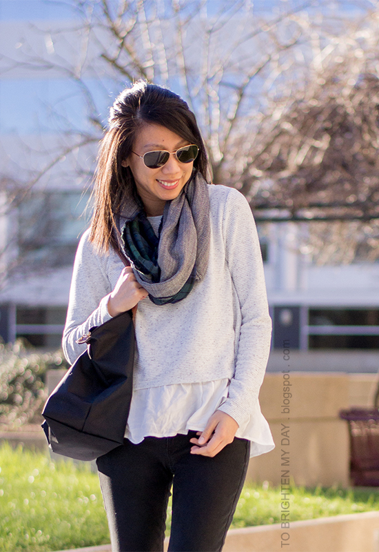 plaid and herringbone infinity scarf, gray ruffled sweater, black pants