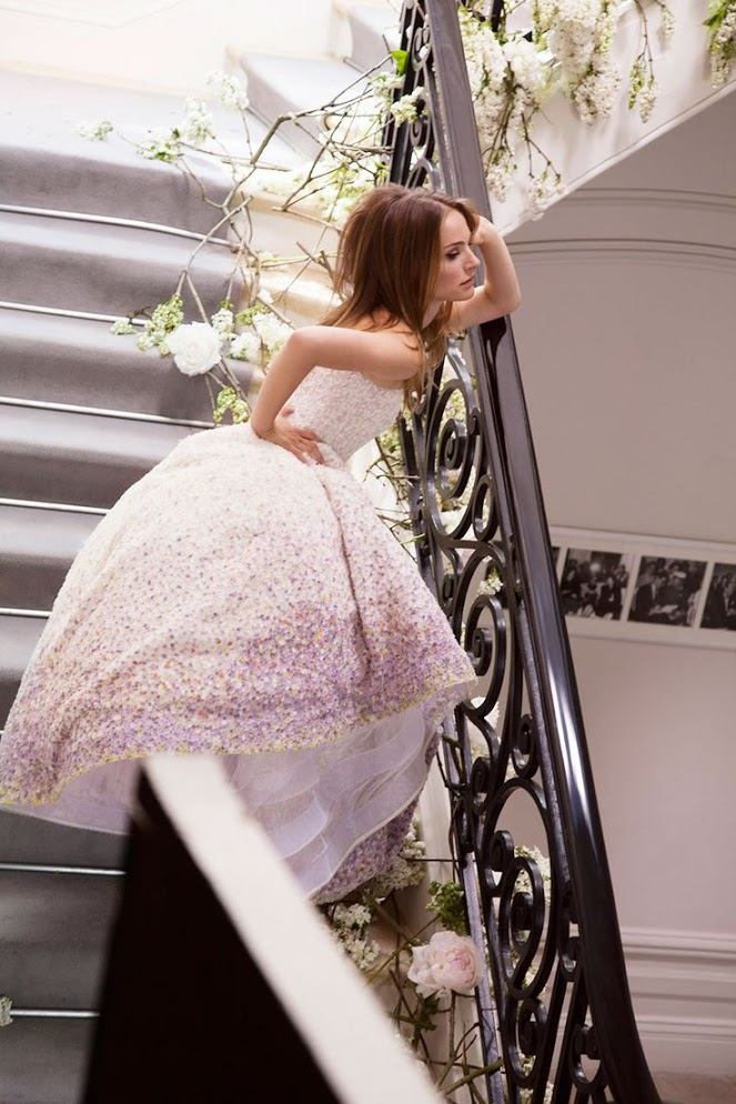 dressed in white on the stairs
