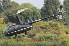 G-CHKW - 2005 build Robinson R44 Raven, departing down Runway 26 after a brief visit to Barton