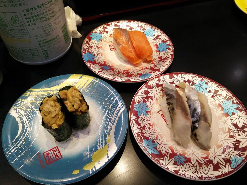 Sushi plates at a kaiten, Narita Airport