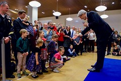 U.S. Secretary of State John Kerry greets the children of staffers at U.S. Embassy Berlin in Berlin, Germany, on December 5, 2016, before a bilateral meeting with German Foreign Minister Frank-Walter Steinmeier, and his receiving the Order of Merit from the German government. [State Department photo/ Public Domain]