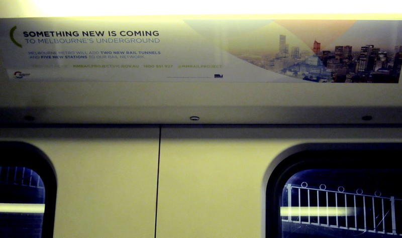 Advertising for Melbourne Metro rail tunnel in a train