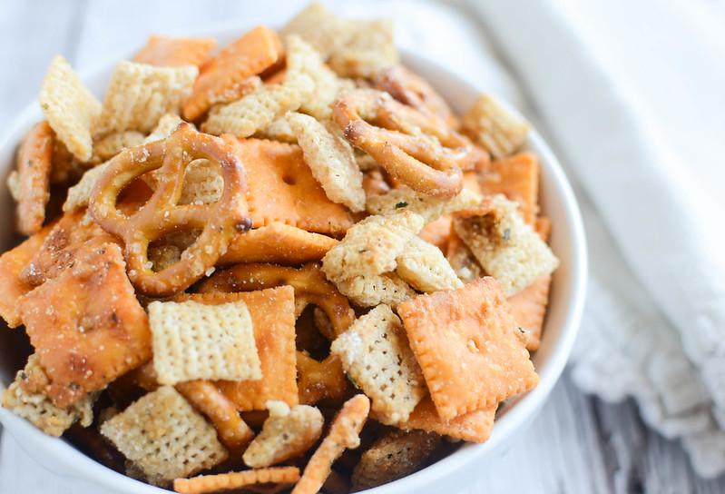 Cheesy Ranch Chex Mix - Chex cereal, crackers, and pretzels coated in a delicious parmesan and ranch seasoning. Seriously addictive!