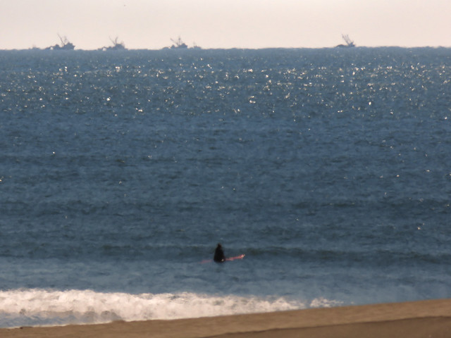 surfer and fishing boats; Ocean Beach, San Francisco (2015)