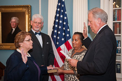 Counselor of the Department Tom Shannon swears in U.S. Ambassador to Kyrgyzstan Sheila Gwaltney at the U.S. Department of State in Washington, D.C., on August 20, 2015. [State Department photo/ Public Domain]