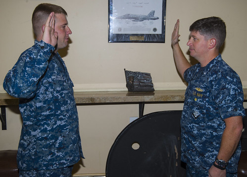 First Sailor Assigned to USS John P Murtha Extends Reenlistment