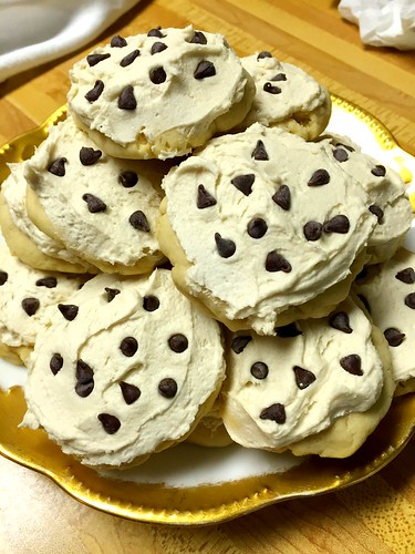 Soft sugar cookies with chocolate chip cookie dough frosting