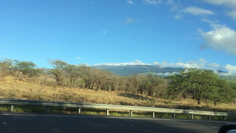 Some sort of smoke or clouds in the mountains on the way to Makena Beach.