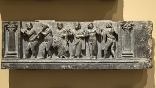 Gandhara schist relief depicting a bacchanalian procession, with Corinthian columns