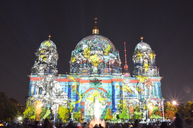 Berlin Festival of Lights 2015 Berliner Dom cathedral with colorful angels and TV tower behind