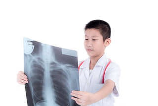 Asian medical doctor boy looking at a x-ray image on white.