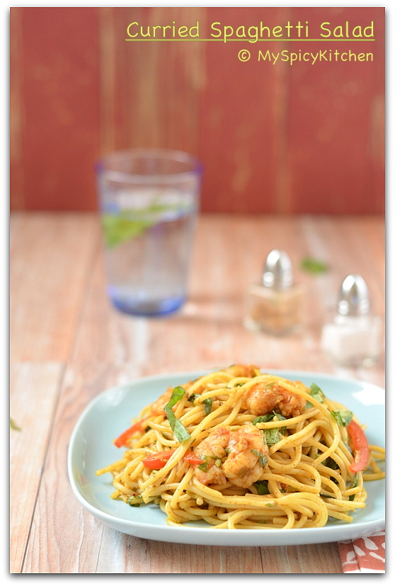 Curried Spaghetti Salad in a blue plate