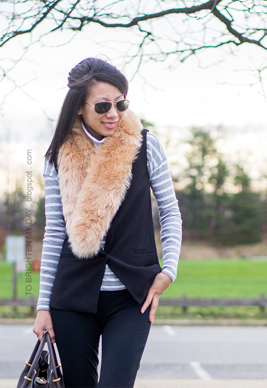 faux fur scarf, gray striped turtleneck, black vest