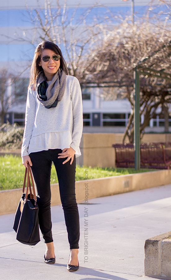 plaid and herringbone infinity scarf, gray ruffled sweater, black pants, black ballet flats