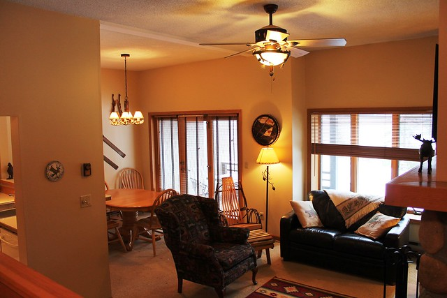 From the entryway looking toward the living/dining area; off the dining room with glass doors leading to front patio offering fantastic views of the lake and mountains.