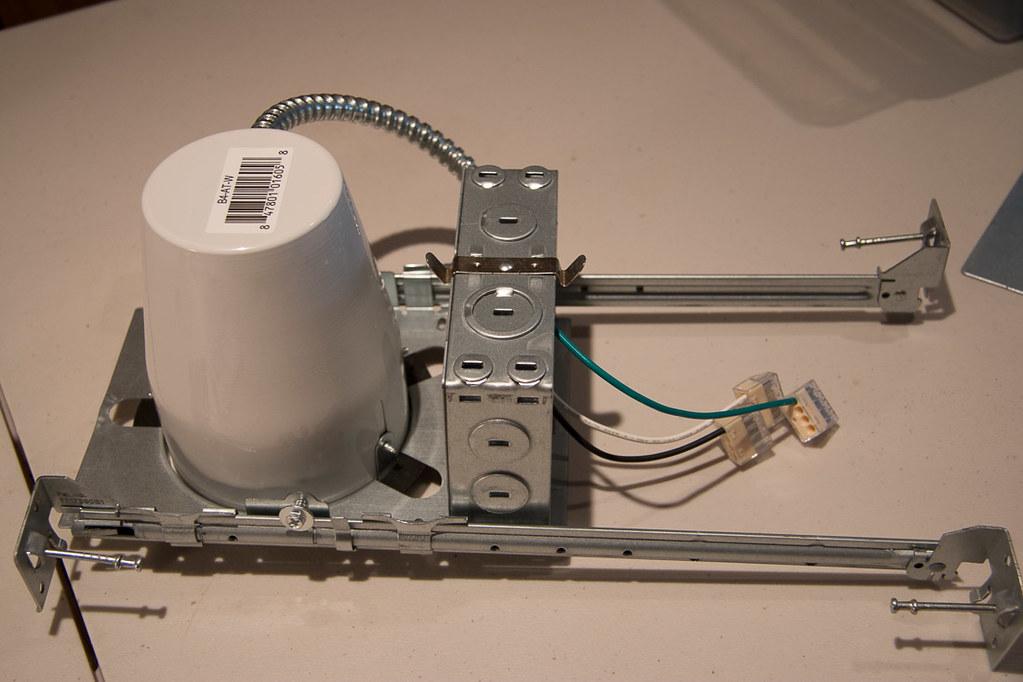 Preparing recessed lighting fixtures for installation