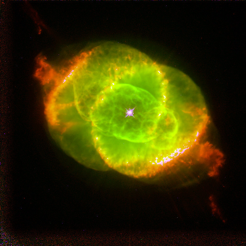 The Cat's Eye Nebula, a planetary nebula formed by the death of a star