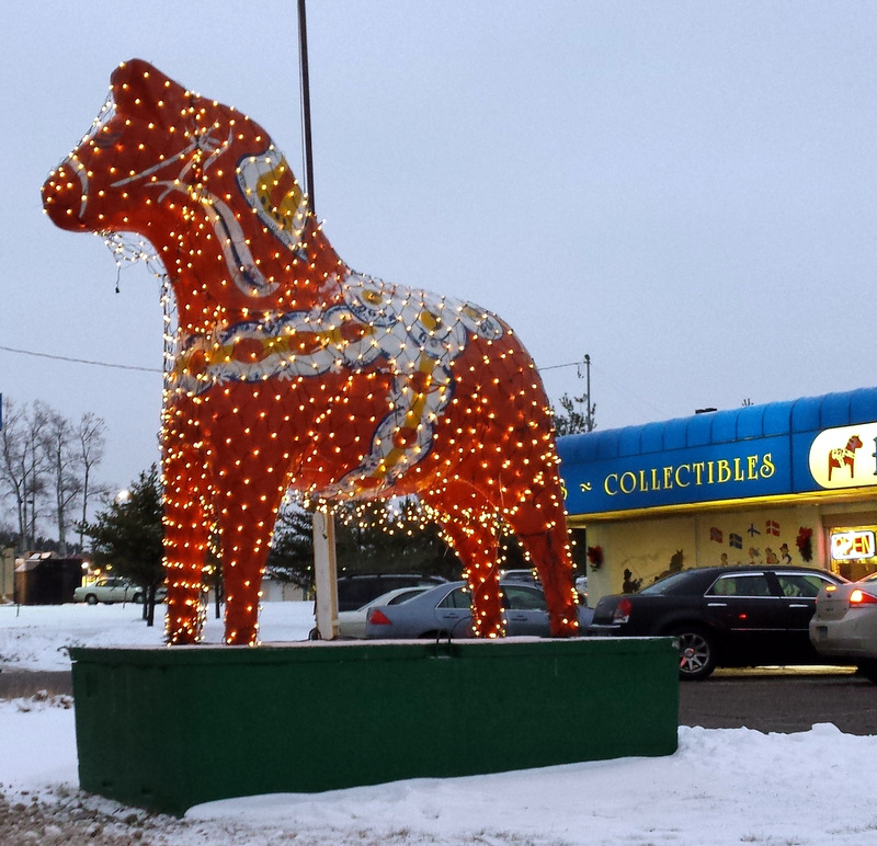 Dala horse covered in net Christmas lights