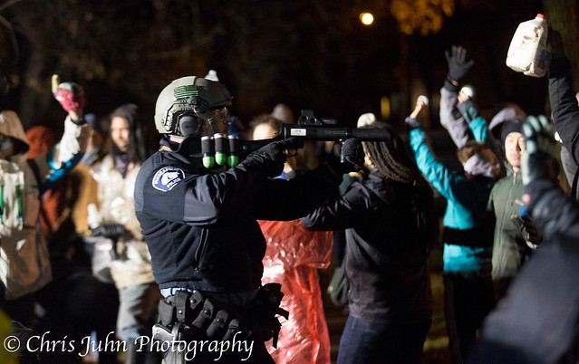 MPD points gun into crowd