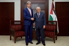 Palestinian Authority President Mahmoud Abbas greets U.S. Secretary of State John Kerry before a bilateral meeting on November 24, 2015, at the Muqata'a Presidential Compound in Ramallah, West Bank. [State Department photo/ Public Domain]