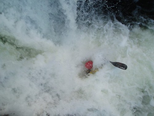 Greg disappearing into the plumes of whitewater