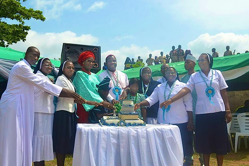 Cutting the anniversary cake at the 25th anniversary of St Josephs school