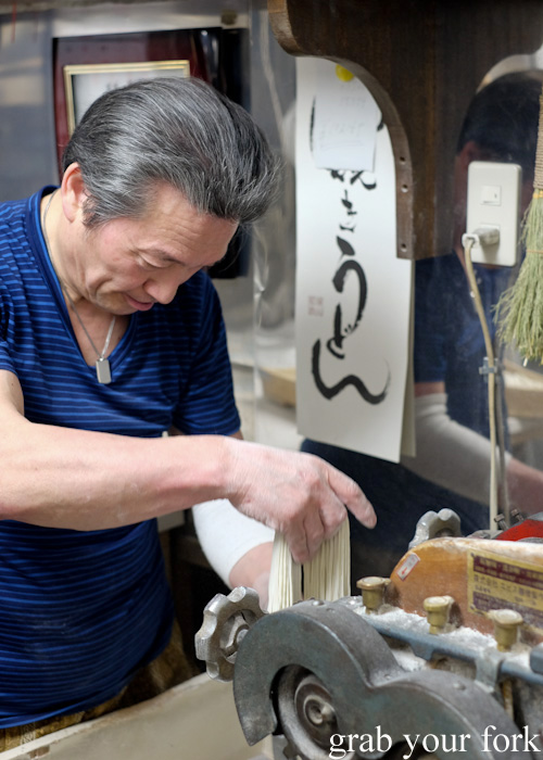Shaking off the excess flour from fresh soba in Otaru, Hokkaido