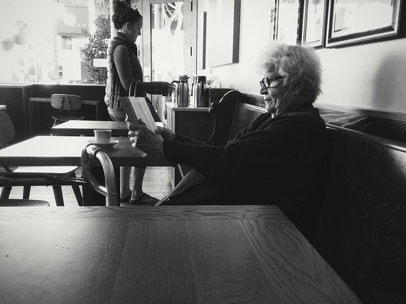 cafecito, books, awesome white hair. earlier today i found mi kindred spirit at peets <3