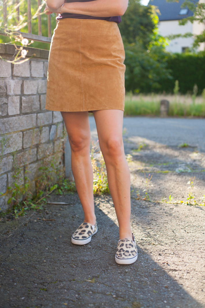 Outfit: suede A-line skirt, leopard slip ons