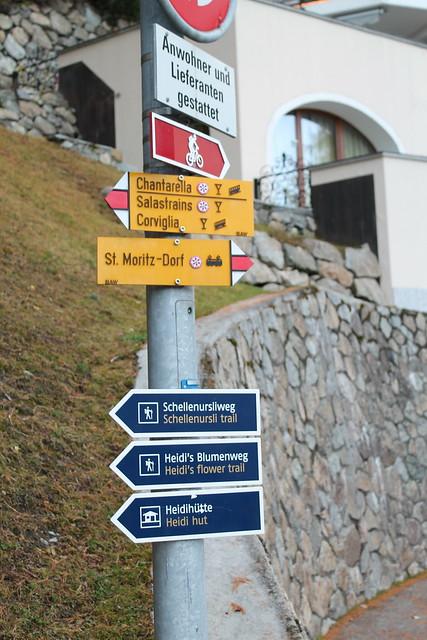 signpost st moritz town to heidi hut