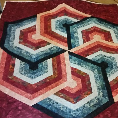 Whirlwind is quilted! I also showed the neighbors how the frame and machine worked. Love quilting and the relationships it builds.