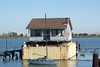 This house has been in the San Joaquin River for some years now, it can be seen from the start of A Street. There is even a small sailing boat anchored infront of it.