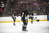 The Hershey Bears carry equipment to the penalty box after a fight. by hartmantori