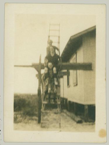 Three on a ladder