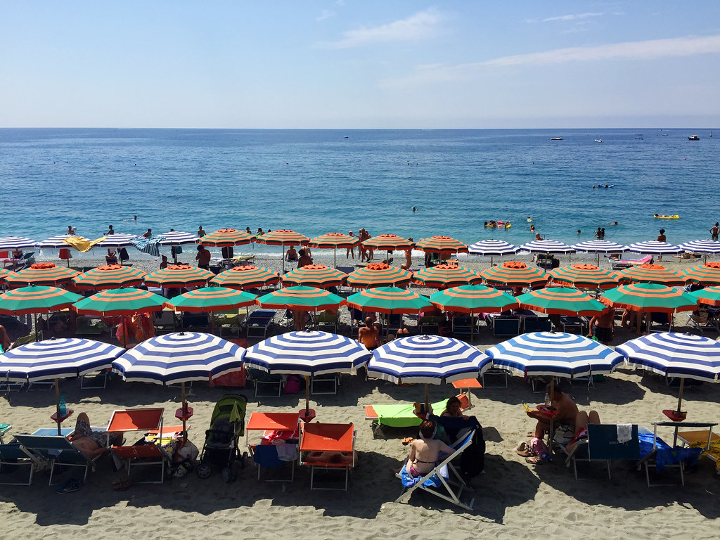 Monterosso Cinque Terre colorful rows of striped beach umbrellas