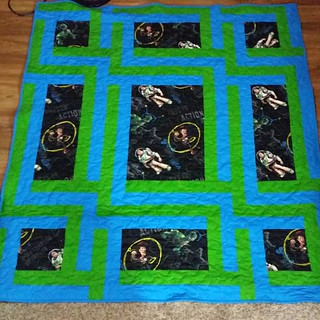 Mathew's Toy Story quilt is done and he's sleeping under it tonight.  Sidelines by Maple island quilts