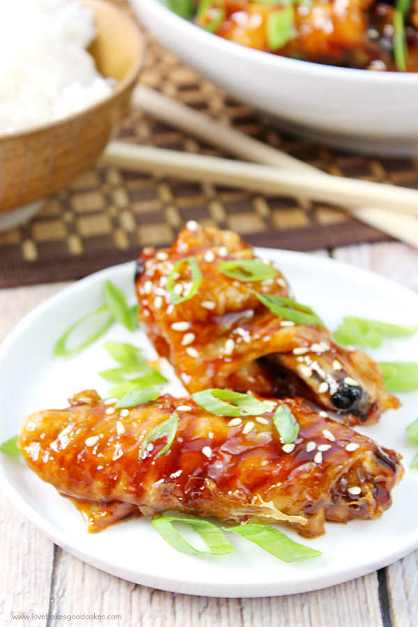 Asian Sticky Wings on a white plate.