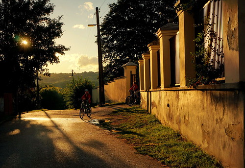 street autumn sunset sun building fall church abbey childhood architecture backlight fence children lights gate iron hungary shadows bikes medieval september railing baroque benedictine bikers origin templom benedictineabbey bencésapátság kapornak nagykapornak