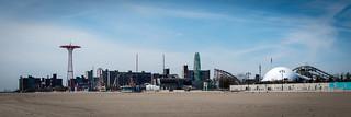 Image of Coney Island Beach near Coney Island. park newyorkcity cloud newyork beach brooklyn coneyisland amusement unitedstates sunny rollercoaster