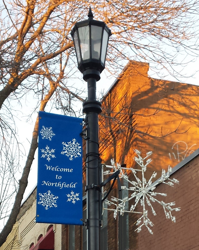 blue Welcome to Northfield banner next to a white snowflake