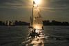 On a boat - toward the sun