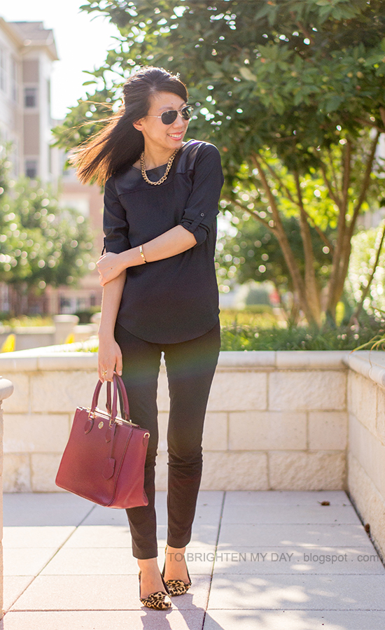black faux leather yoke top, black pants, gold jewelry, red purple tote, leopard flats