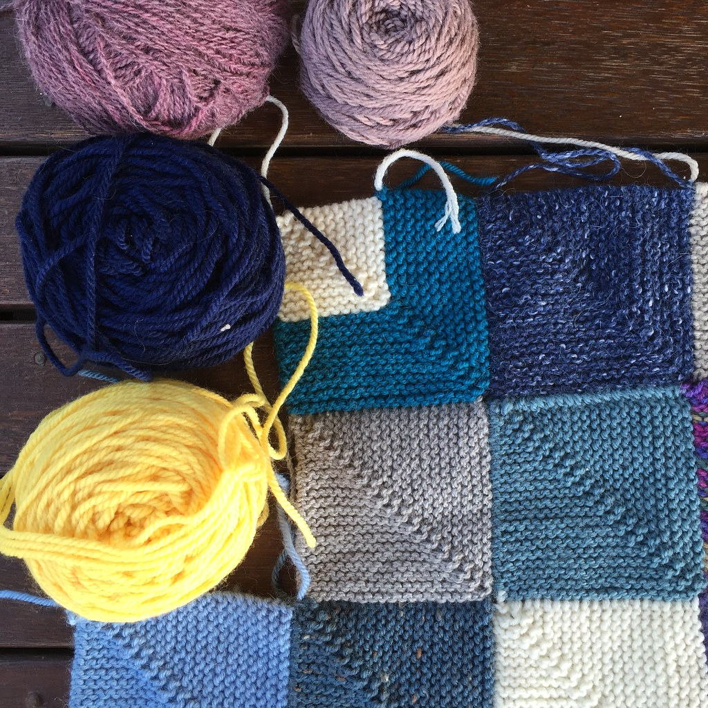 mitred square memory blanket with four balls of yarn to knit up