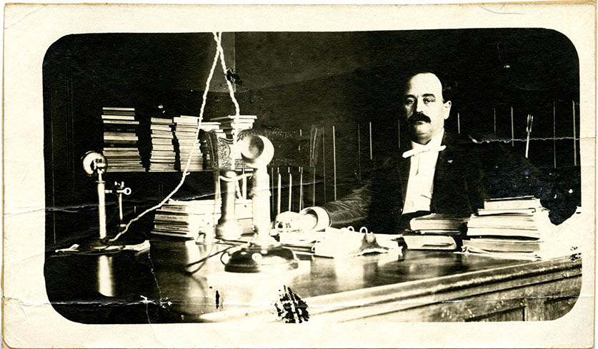 Samuel Palmer Brooks in his office, undated